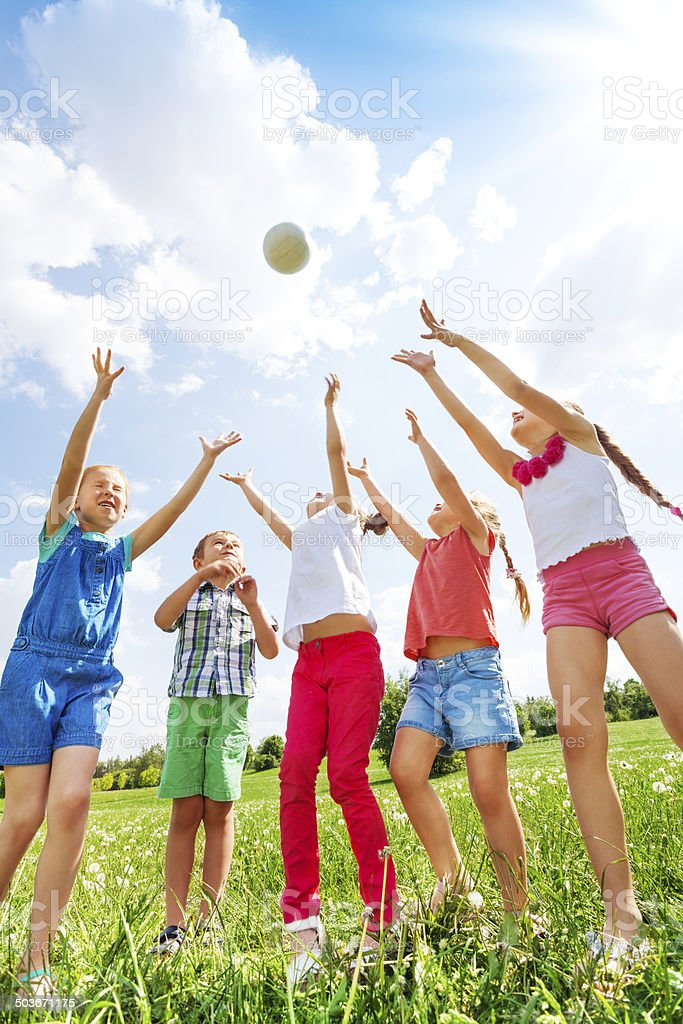 Children playing with a ball stock photo