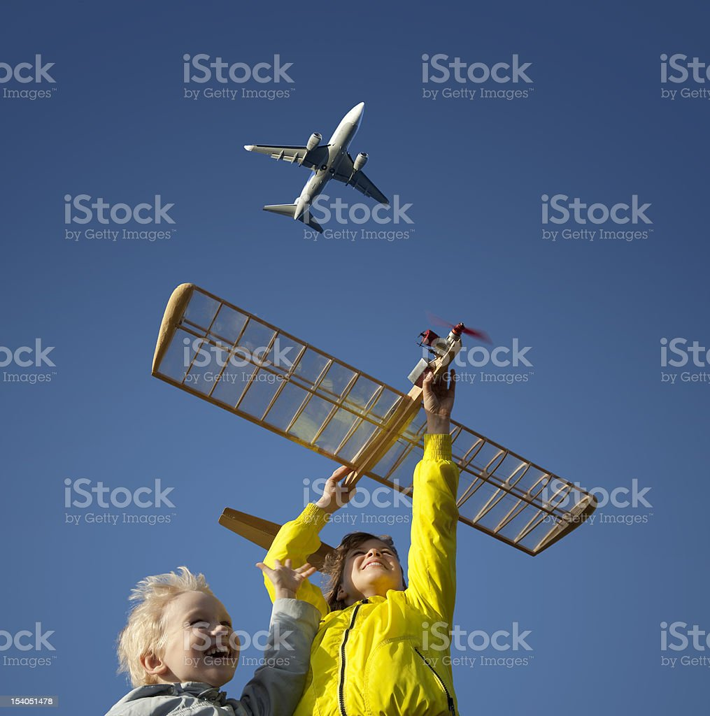 Children playing with a model glider royalty-free stock photo