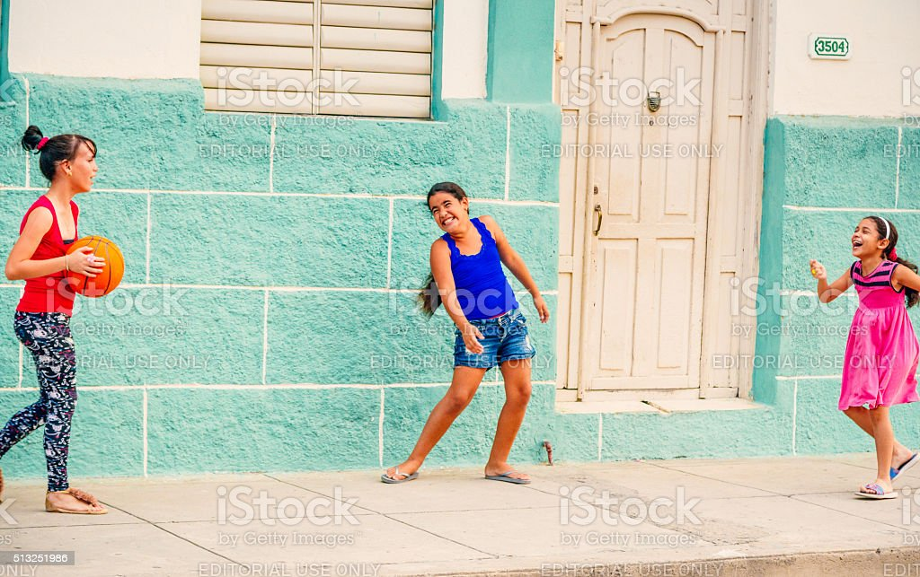 Children playing with ball in the street, Cuba stock photo
