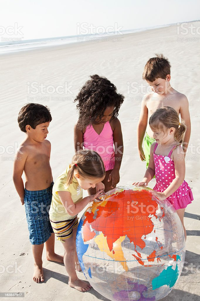 Children playing with big beach ball globe royalty-free stock photo