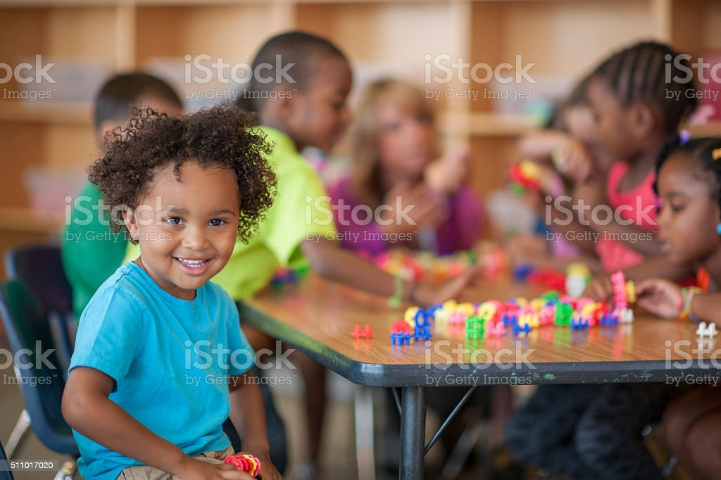 Children Playing with Blocks in Class stock photo
