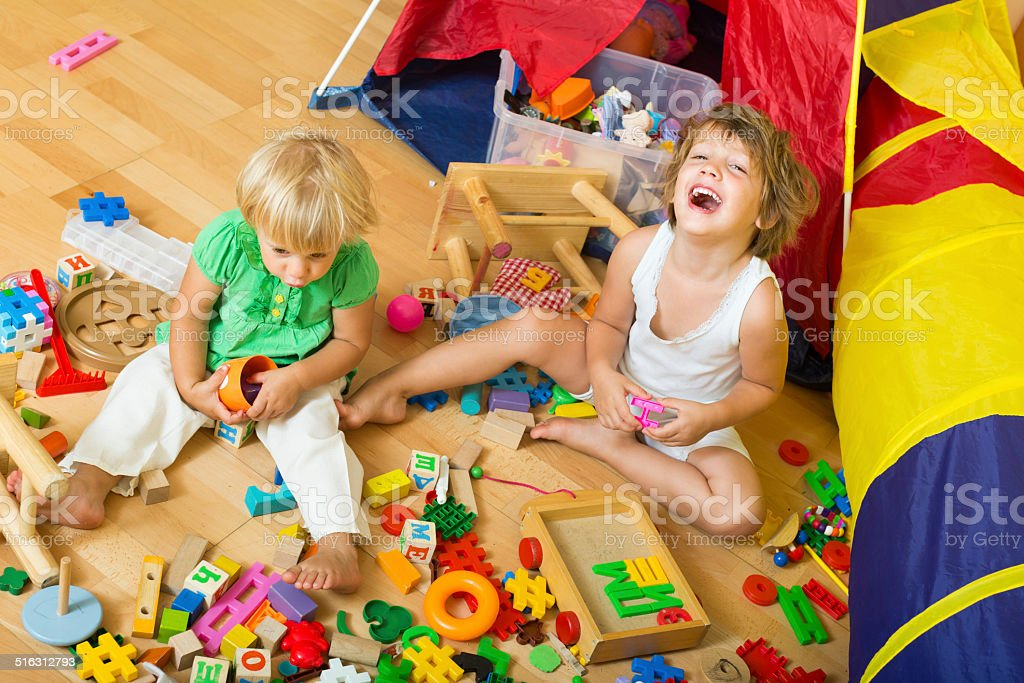 Children playing with blocks stock photo
