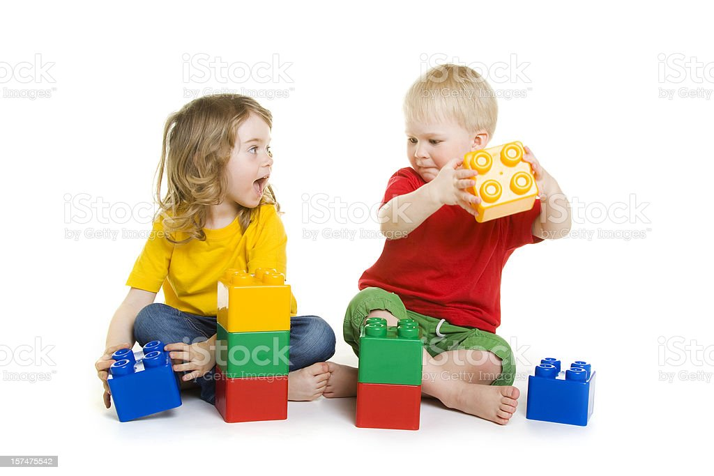 Children playing with bricks royalty-free stock photo