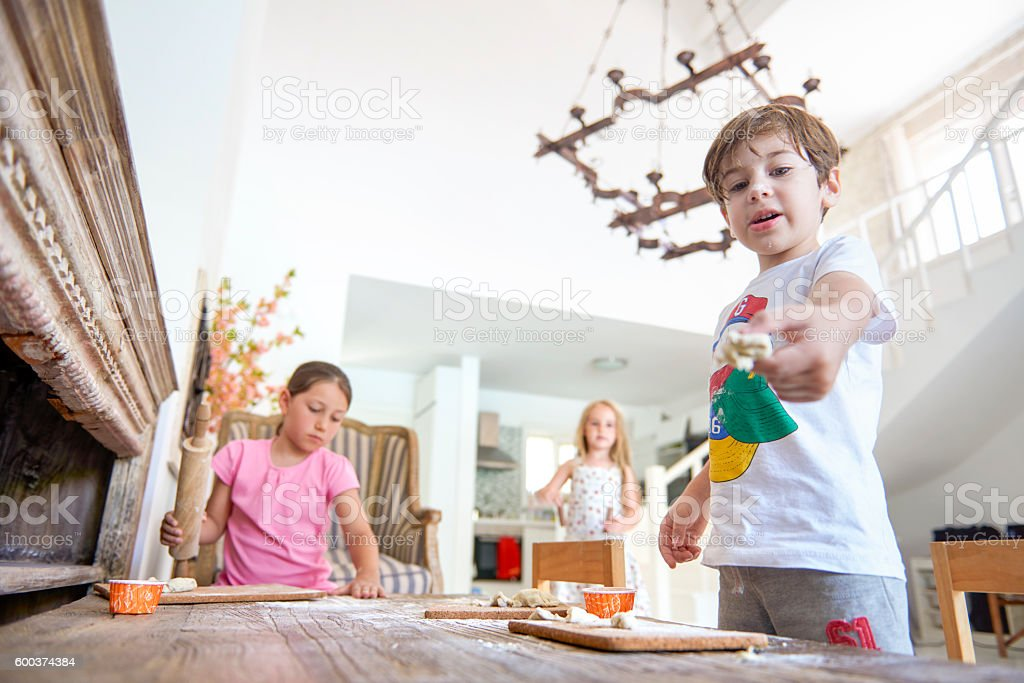 Children playing with dough on table stock photo