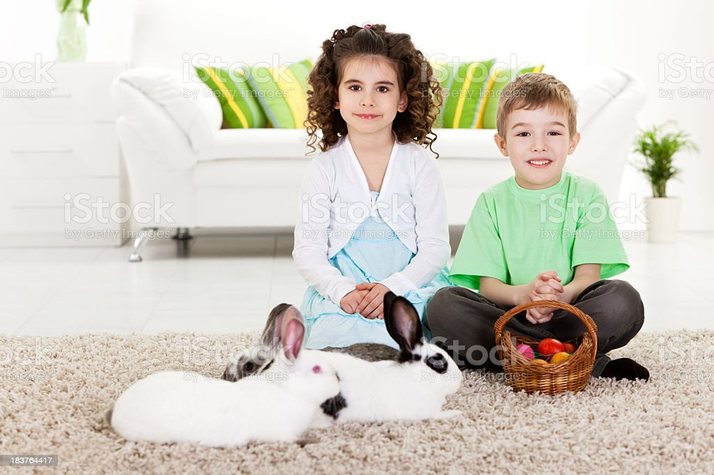 Children playing with Easter bunny and eggs royalty-free stock photo