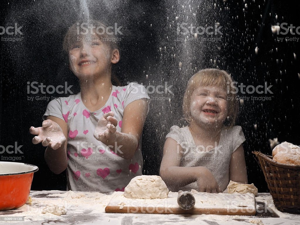 Children playing with flour stock photo