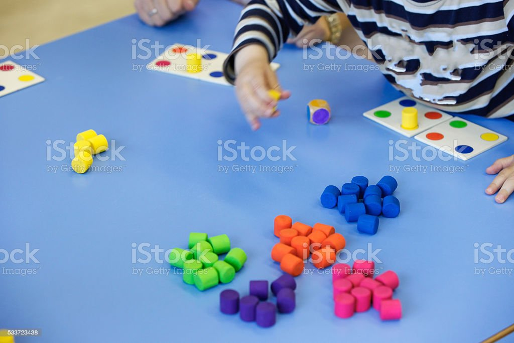 Children playing with homemade educational toys stock photo