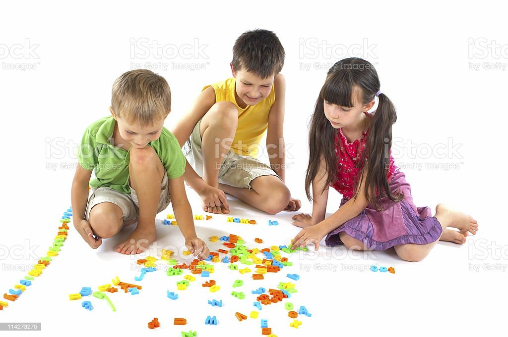 Children playing with letters royalty-free stock photo