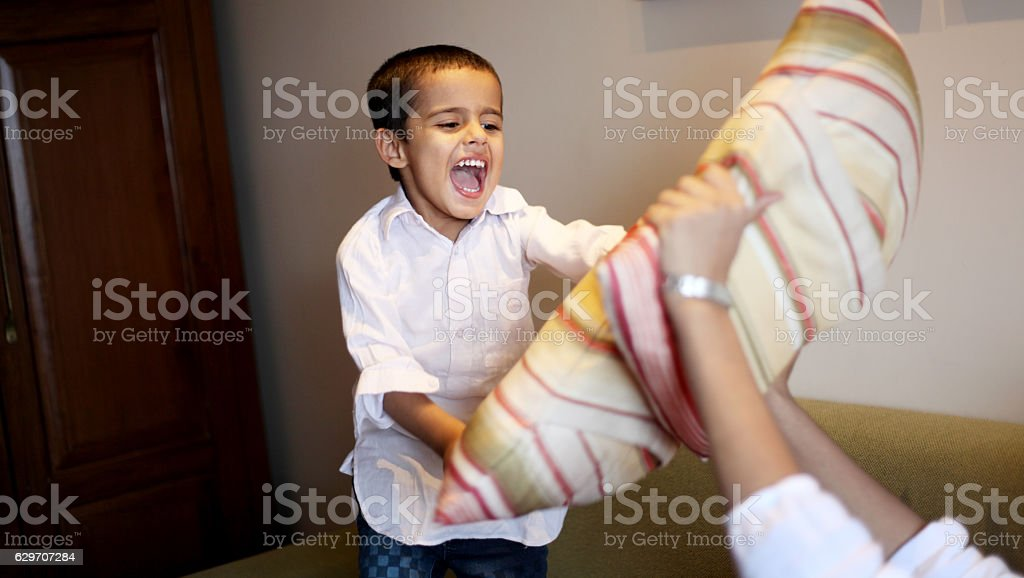 Children playing with pillow stock photo