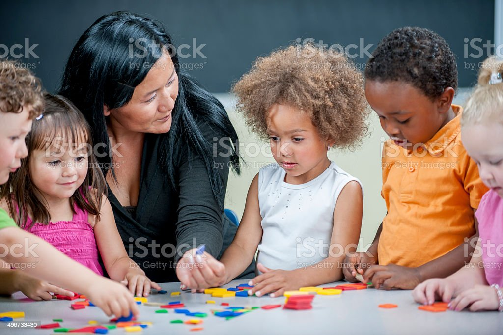 Children Playing with Shapes stock photo