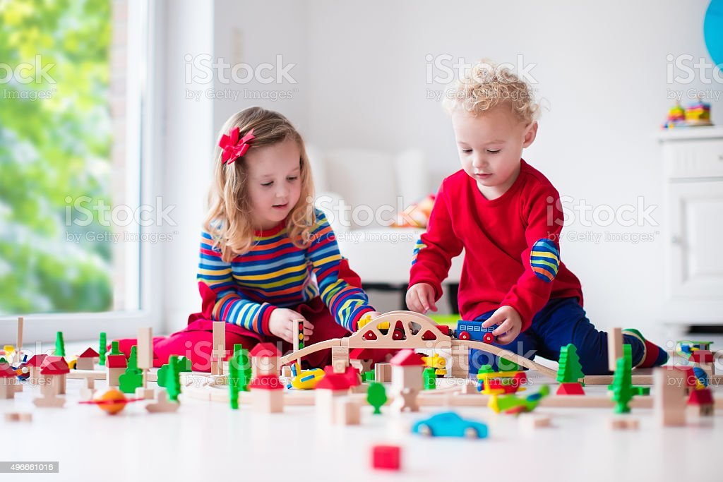 Children playing with toy railroad and train stock photo