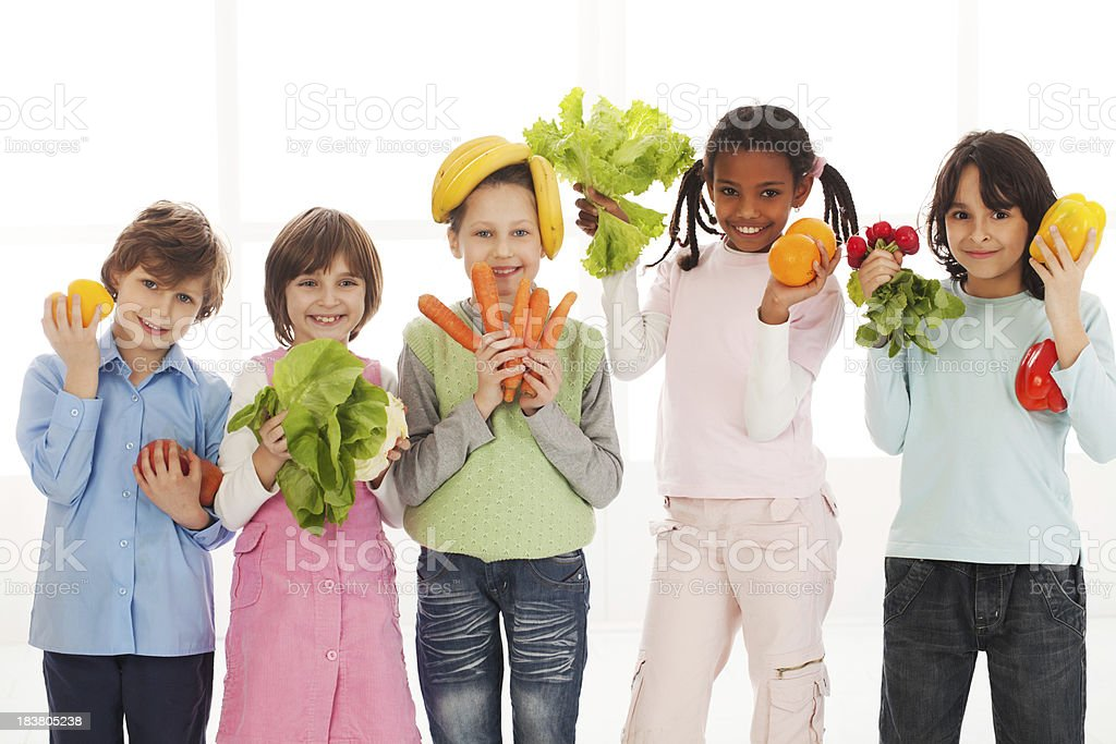 Children playing with vegetables stock photo