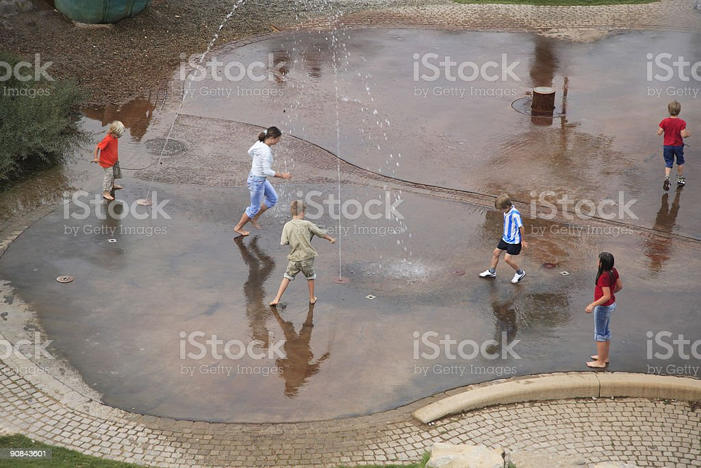 Children Playing with Water royalty-free stock photo