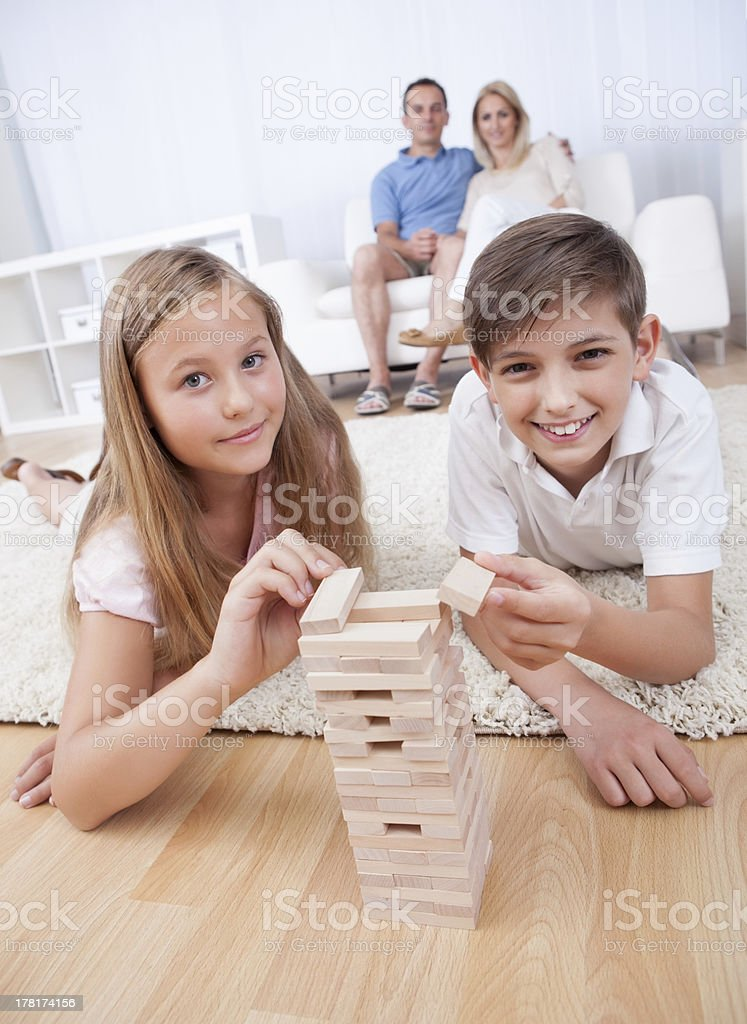 Children Playing With Wooden Blocks royalty-free stock photo