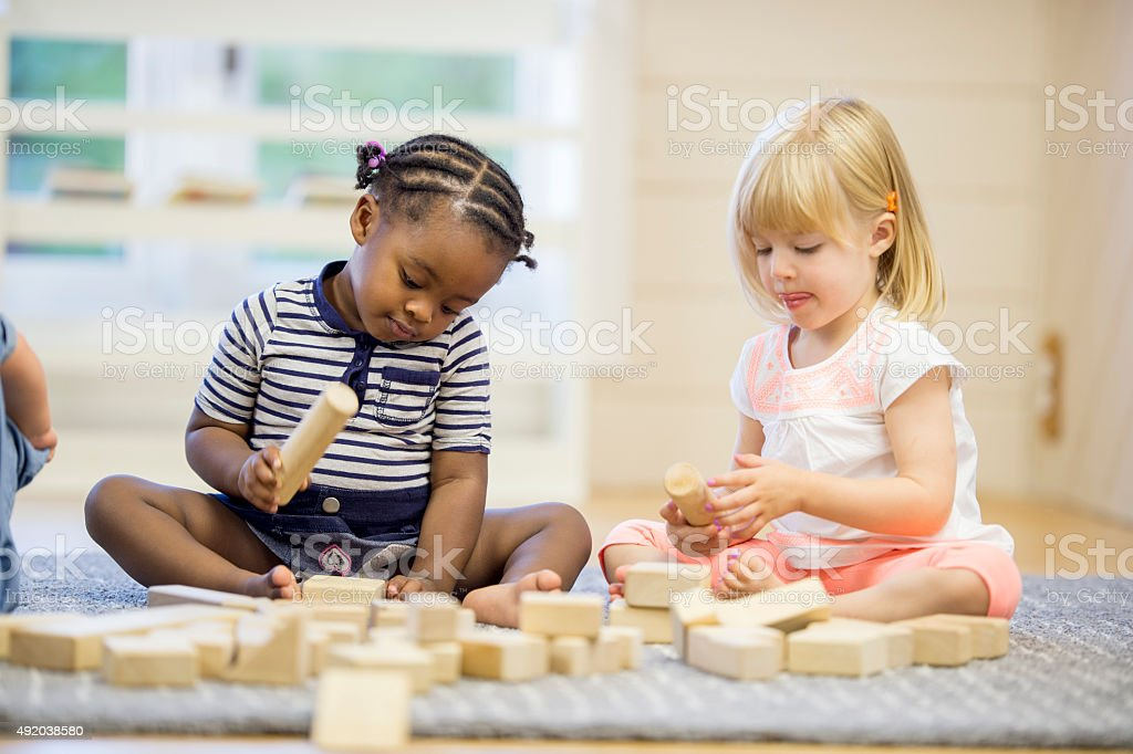 Children Playing with Wooden Blocks stock photo