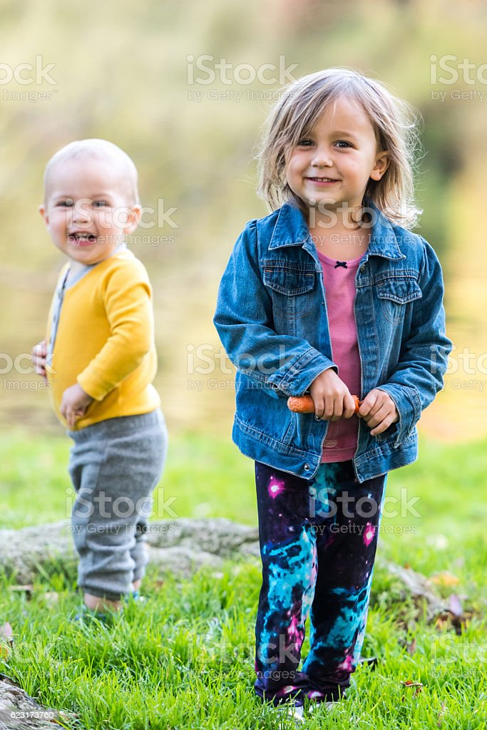 Children posing at a park stock photo