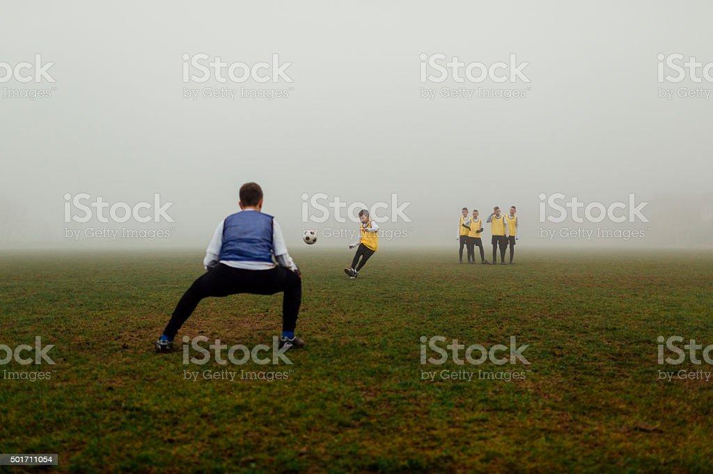 Children Practicing Free Kick At Soccer Training. stock photo