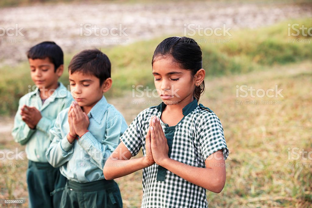 Children praying in the Nature stock photo