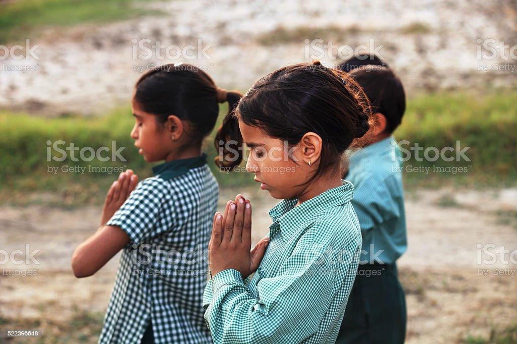 Children praying in the Nature stock photo