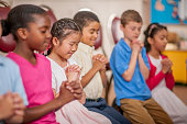 Children Praying Together