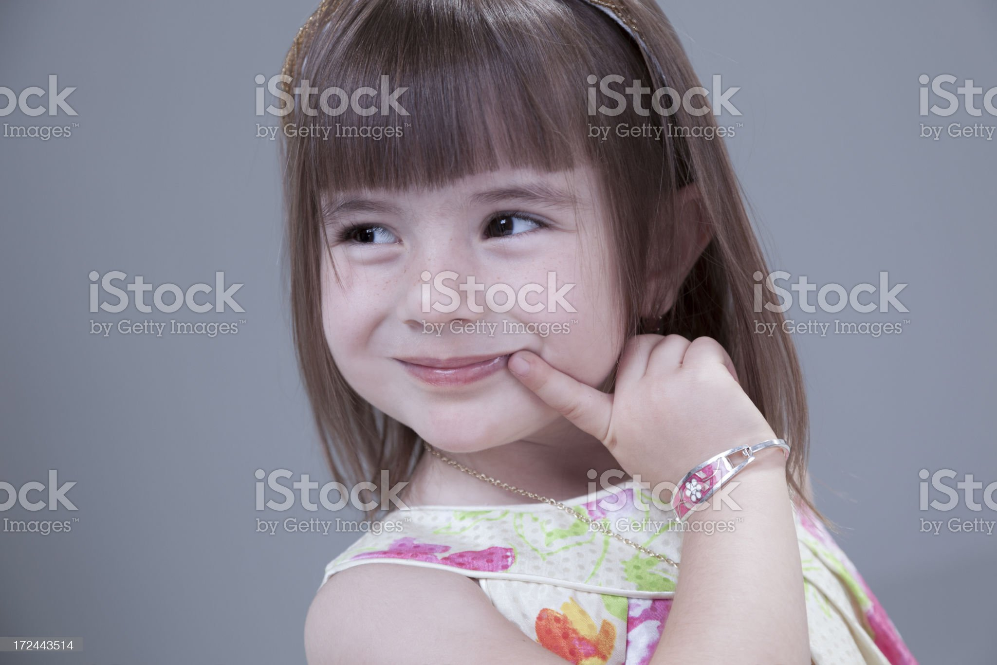 Children: Pre-school little girl watching something funny. royalty-free stock photo