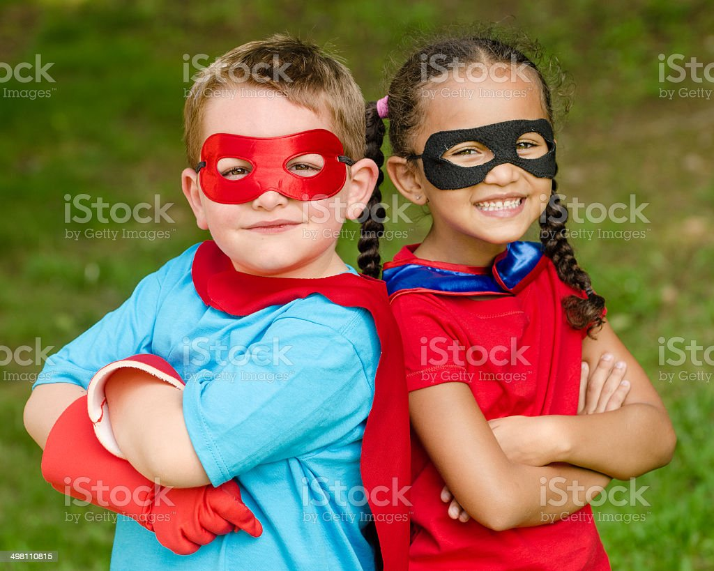 Children pretending to be superheroes stock photo