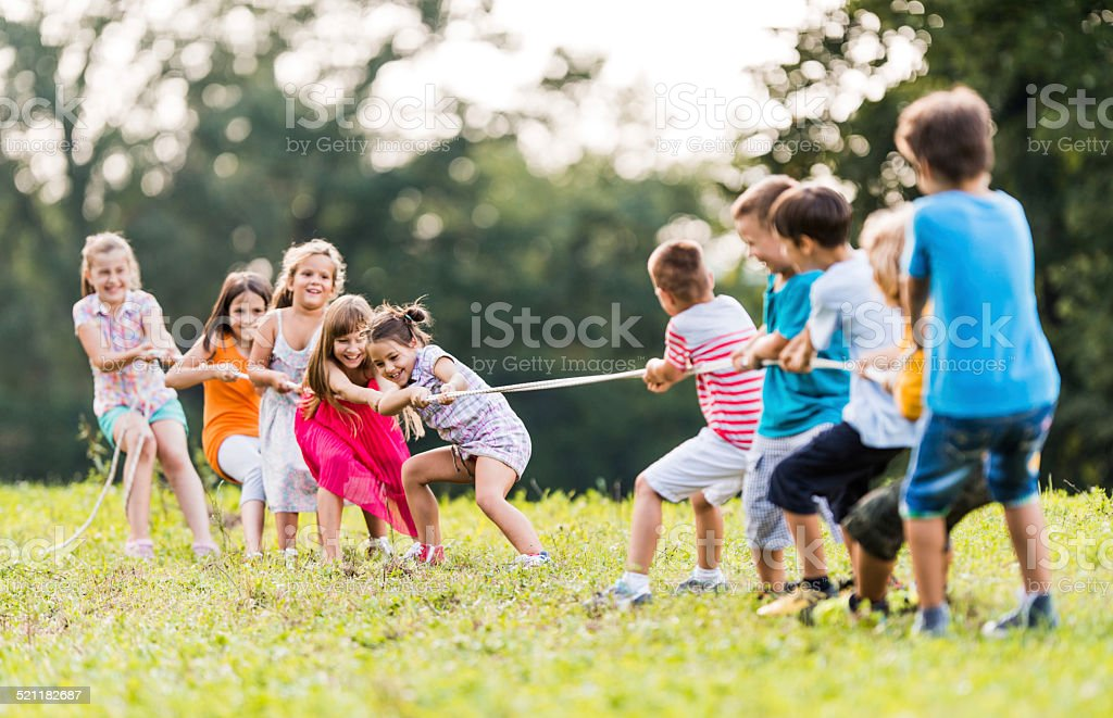 Children pulling a rope. stock photo