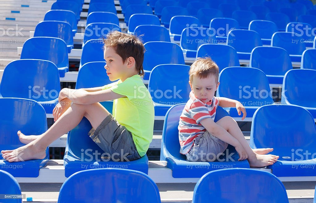 children quarreled and turned away from each other stock photo