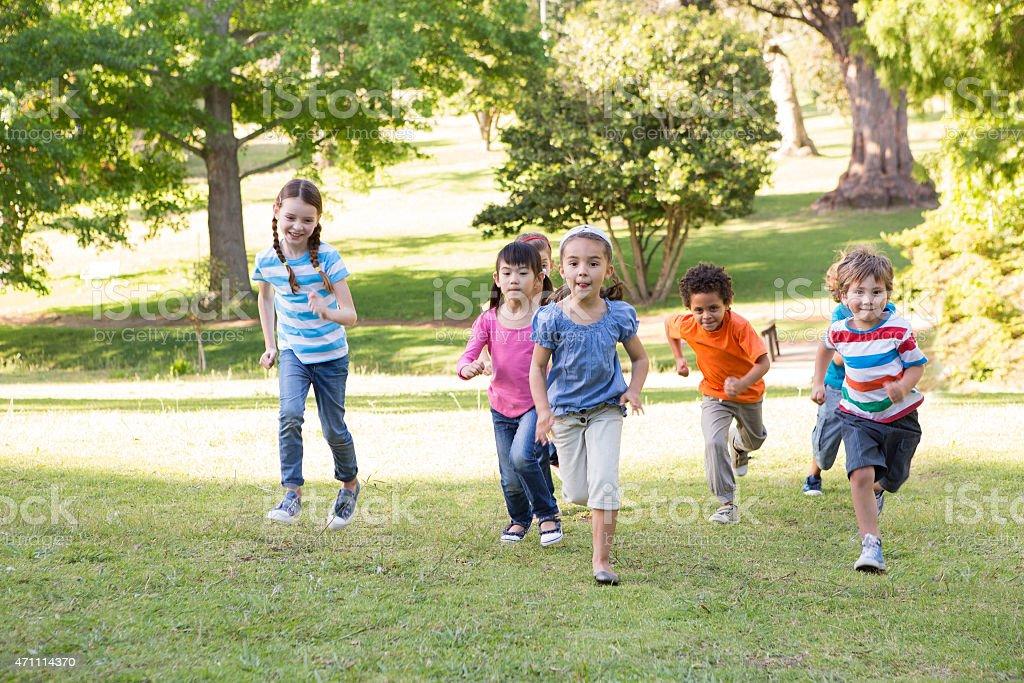 Children racing in the park stock photo