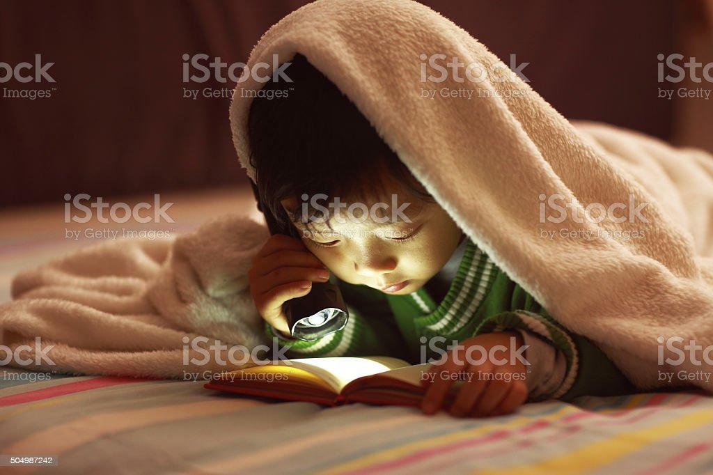 Children read in bed stock photo