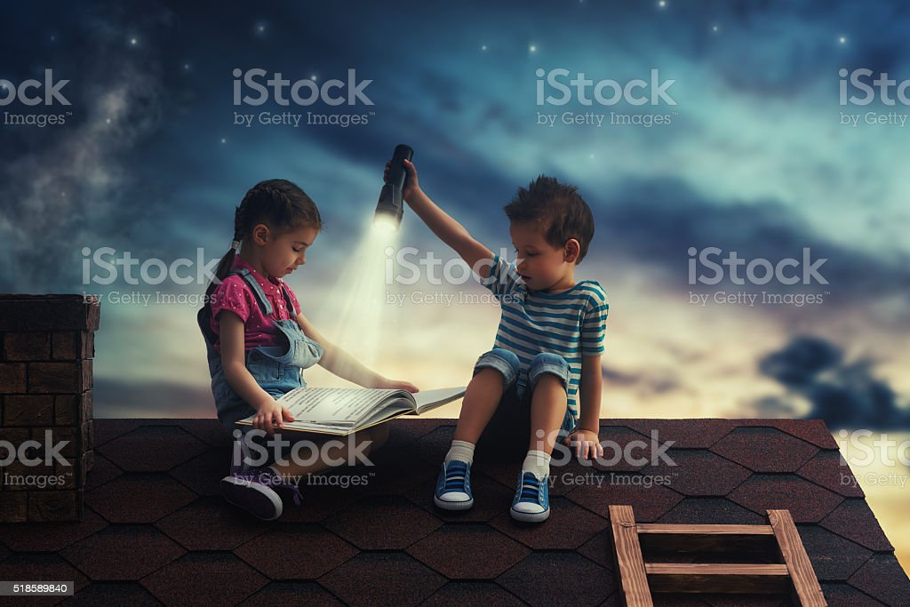 Children reading a book stock photo
