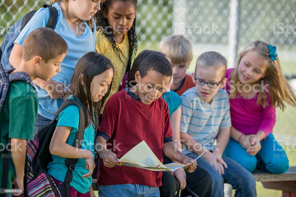 Children Reading a Map Outside stock photo