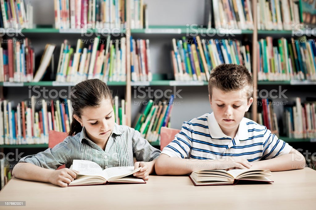 Children Reading in a Library royalty-free stock photo