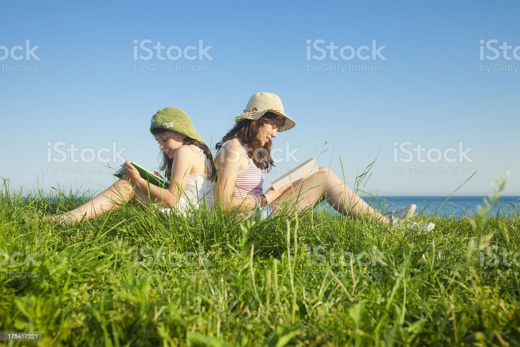 Children reading outdoors royalty-free stock photo