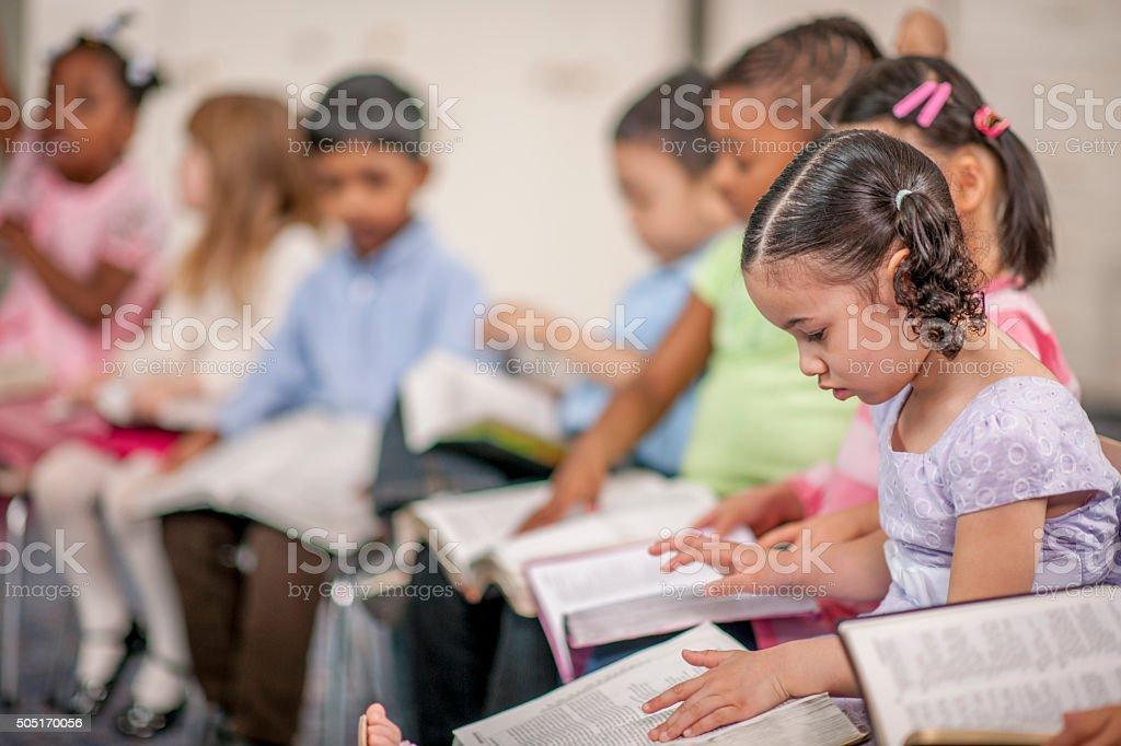Children Reading Scripture at School stock photo