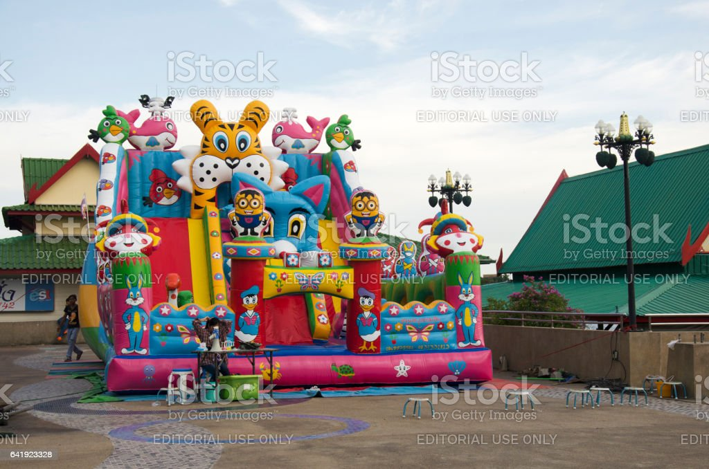 Children relax playing on inflatable playground or inflatable toy stock photo