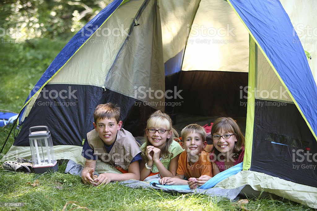 Children relaxing in camping tent royalty-free stock photo