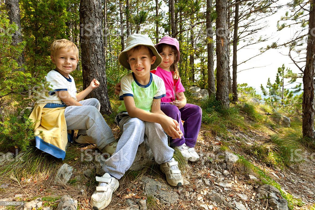 Children Resting In The Forest stock photo