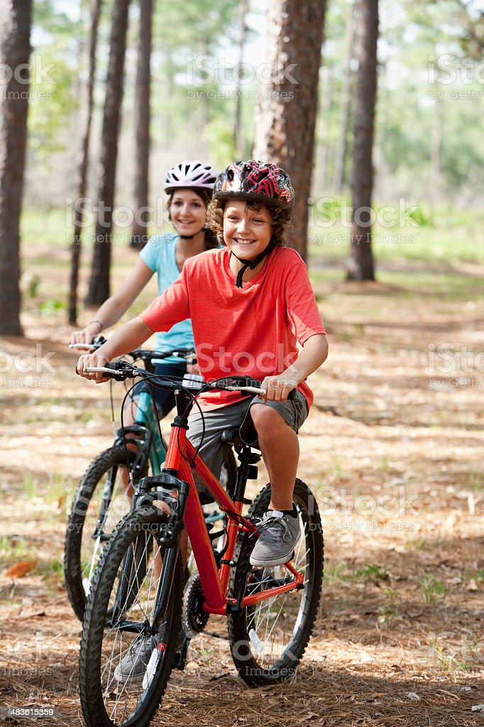 Children riding mountain bikes stock photo