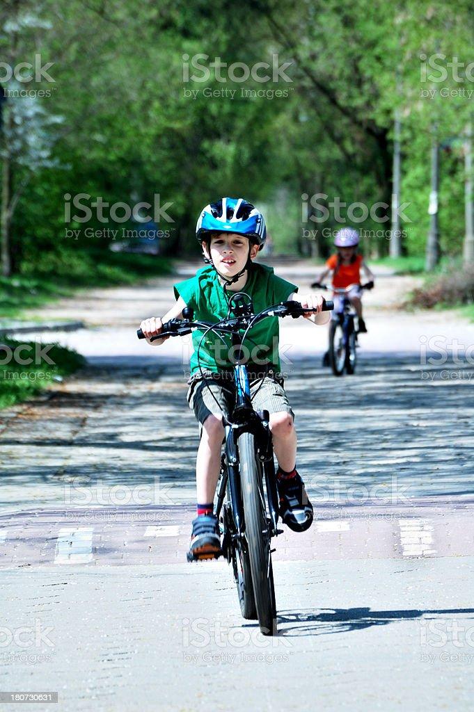 Children riding on  mountain bikes. stock photo