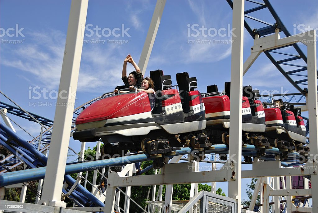 Children riding rollercoaster royalty-free stock photo