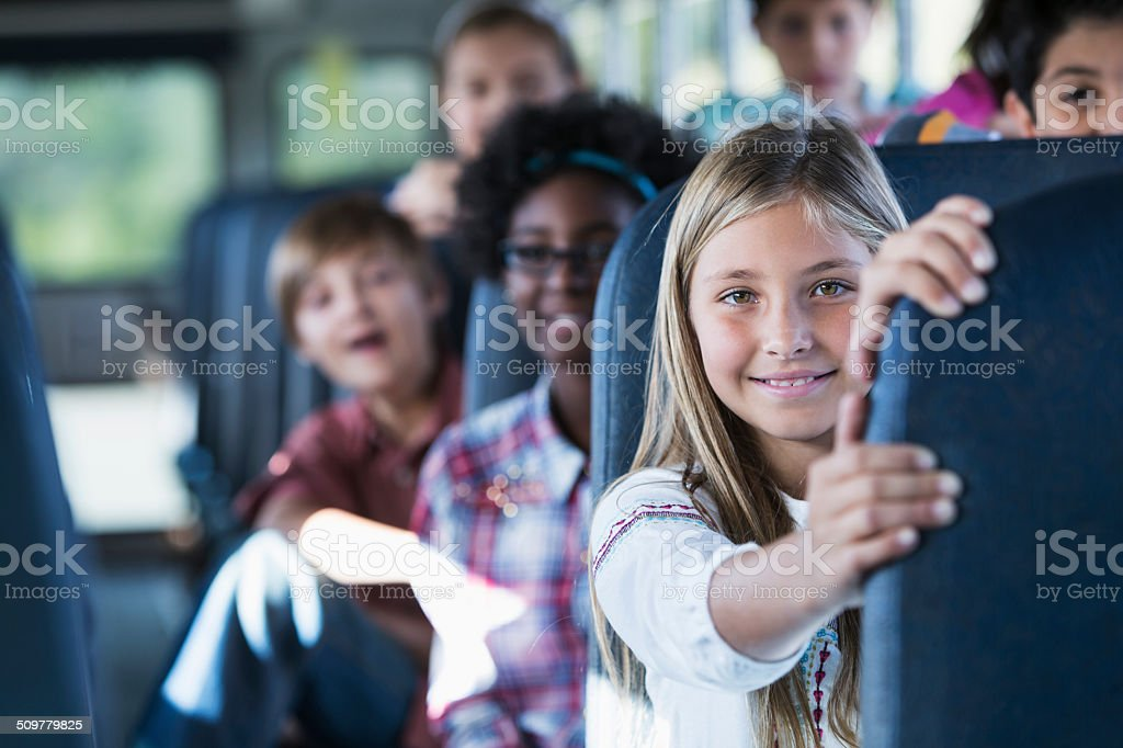 Children riding school bus stock photo