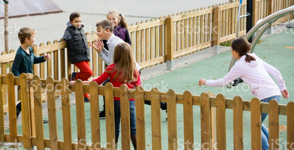 Children running around while playing stock photo