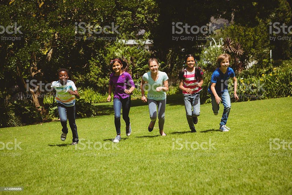 Children running at park stock photo