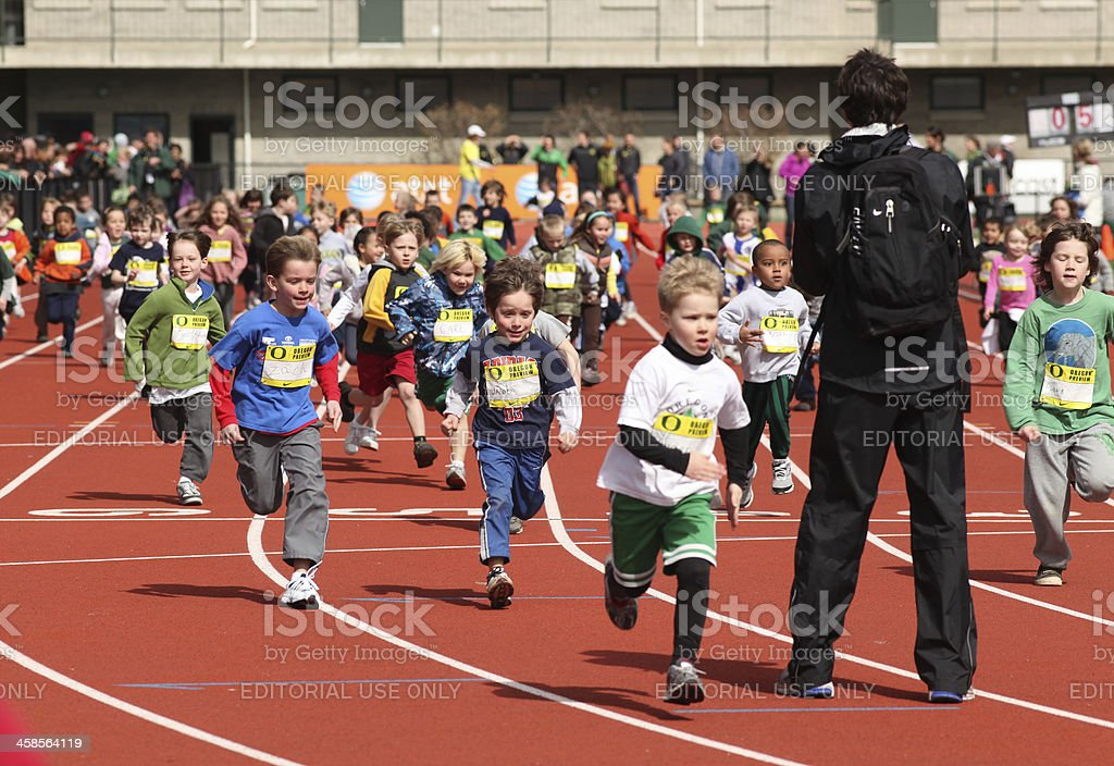 Children Running at Track & Field Youth Clinic stock photo