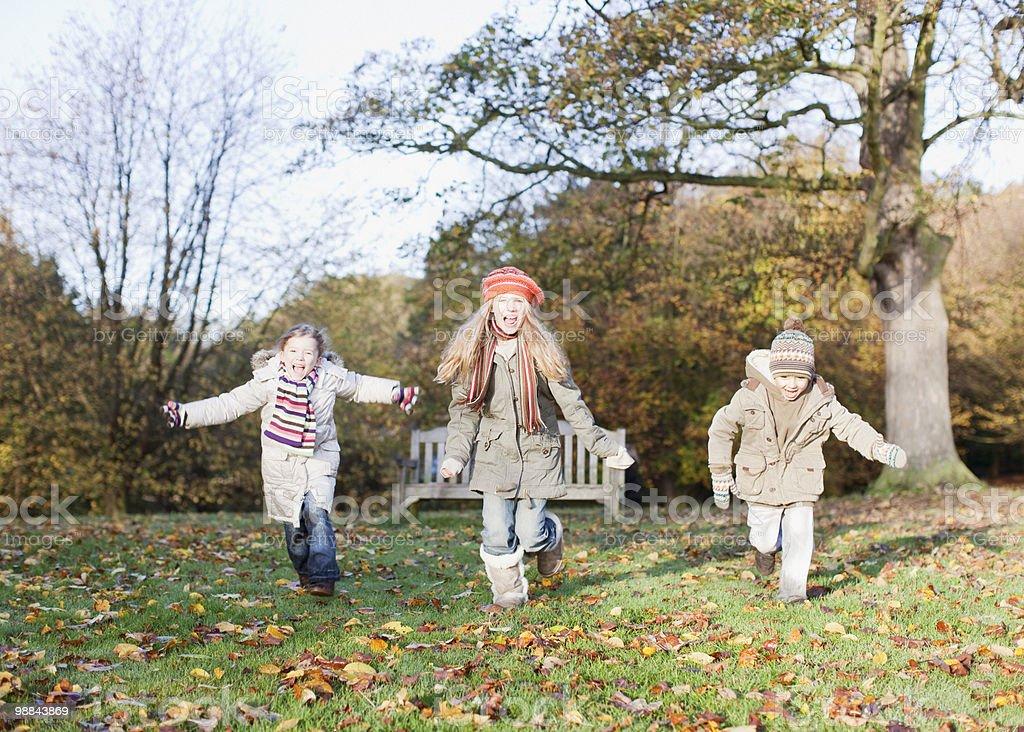 Children running in park in autumn royalty-free stock photo