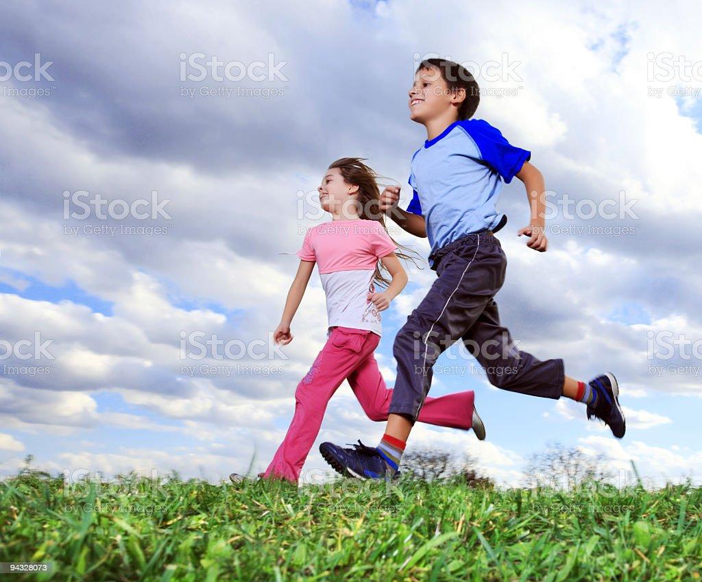 Children running outdoors. royalty-free stock photo