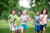 Children Running Through the Grass