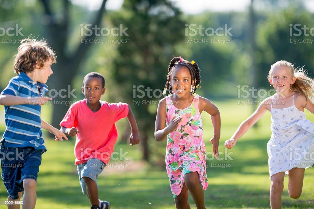 Children Running Through the Park stock photo