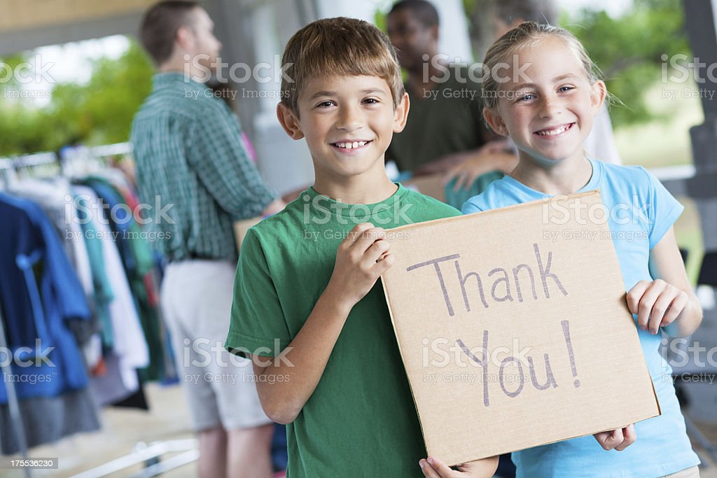 Children saying Thank You at donation center or yard sale royalty-free stock photo